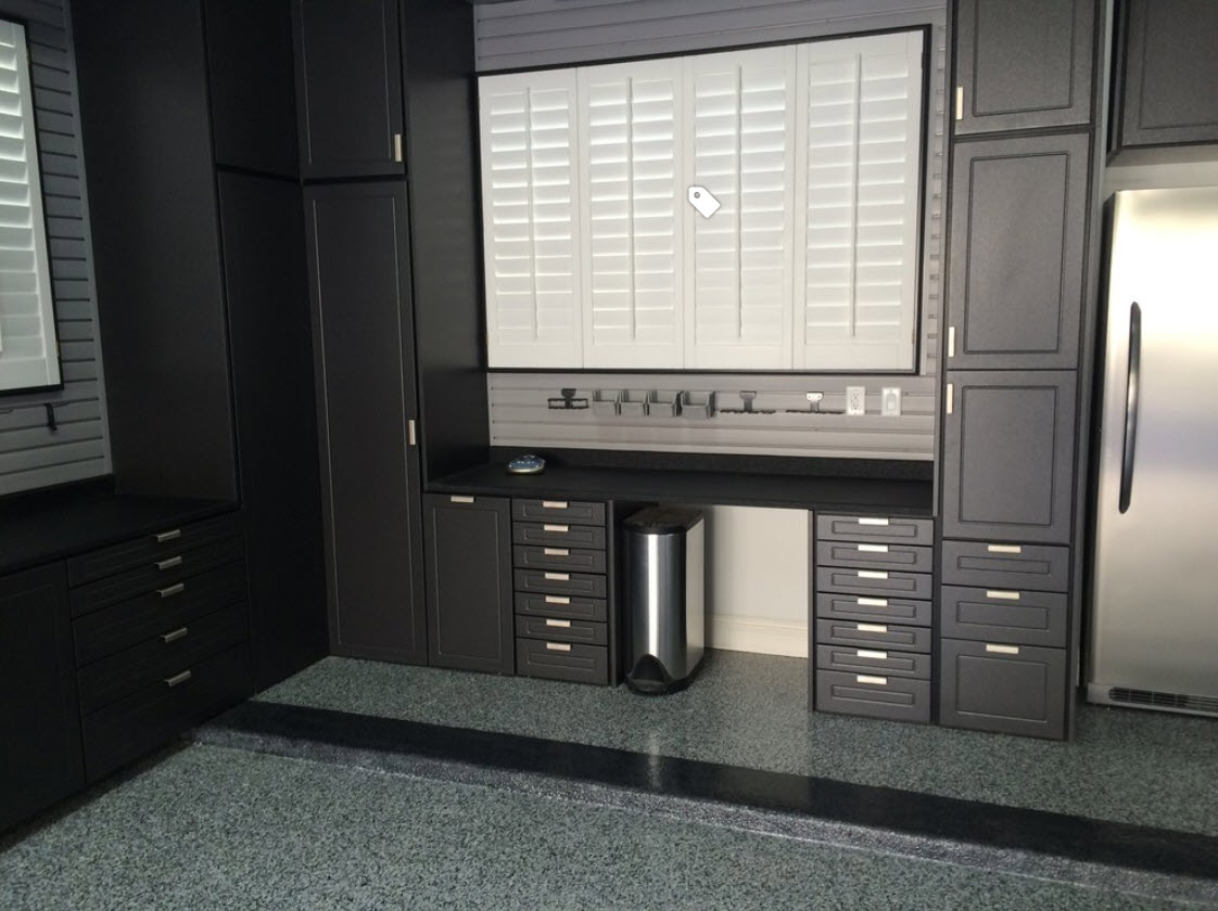 black garage cabinets with workbench